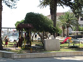 Children's playground in the park in the center of Sucuraj